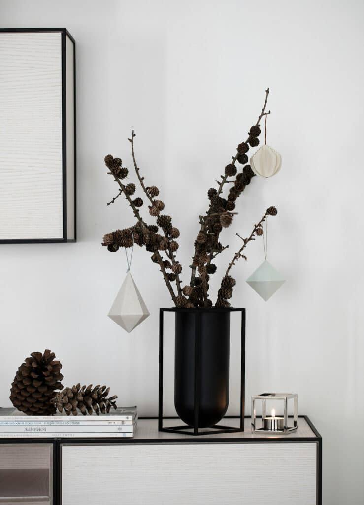 Holiday Decoration - ornaments and pine cones on living room stand
